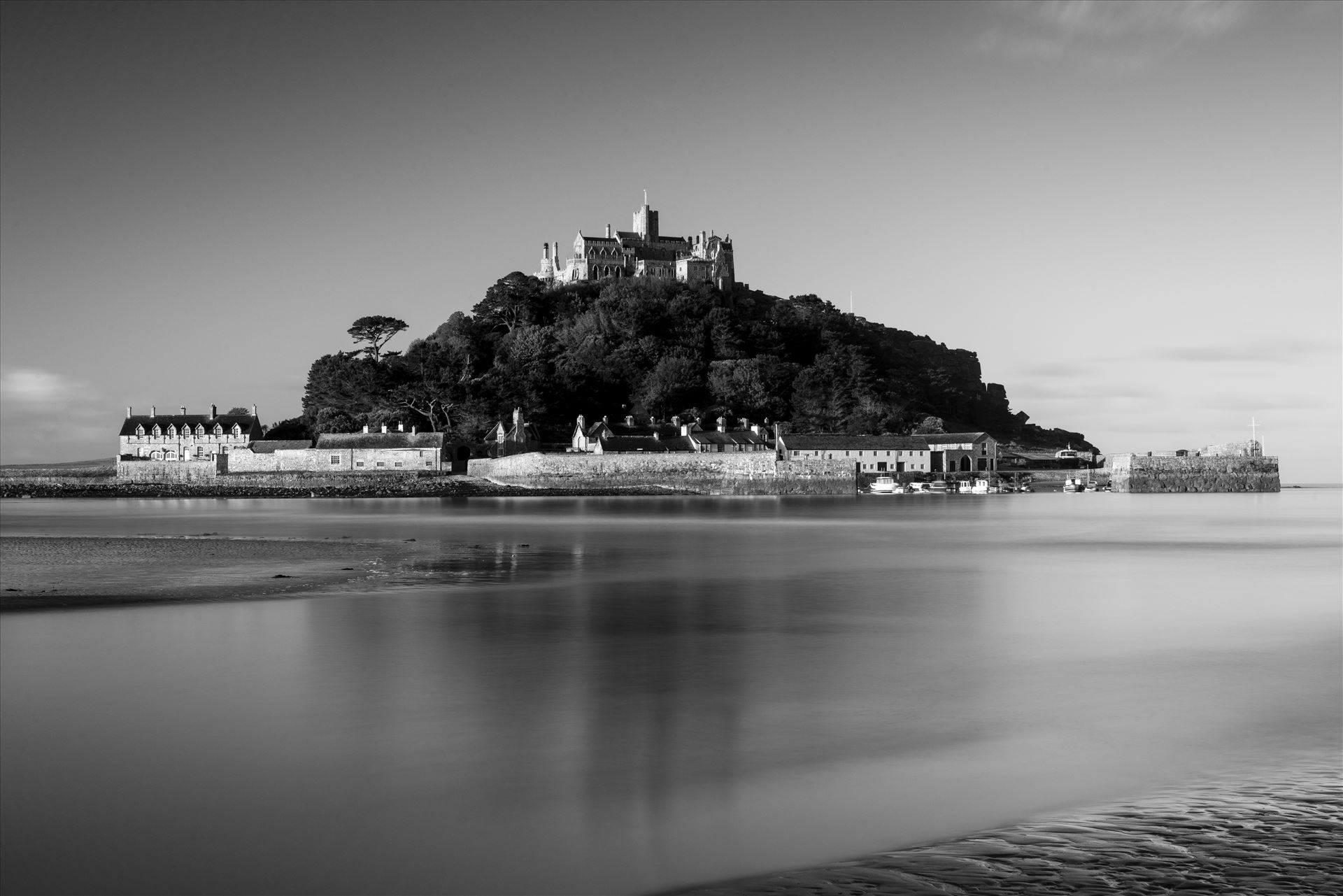 Reflection of St. Michael - This image was shot on location at St. Michael's Mount in Cornwall, UK and is a monochrome version of 'St. Michael's Blues'. by James Etchells Photography
